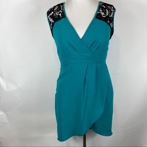Beautiful Teal dress with black  lace inserts
